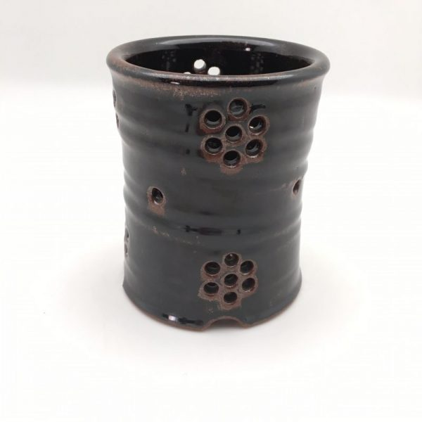 holed black Stoneware Silver Drainer by Lynn Munns